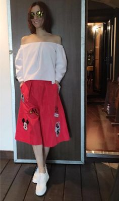 ef3a6d1075 HK singer Sammi Cheng in white off the shoulder top and red loose bermuda  shorts