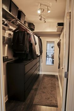 Contemporary Closet with Ikea Malm 6-Drawer Dresser, Built-in bookshelf, Ikea Barometer Ceiling Track, Hardwood floors