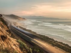 A train zips down the coastline in the beach city Del Mar, north of San Diego, California