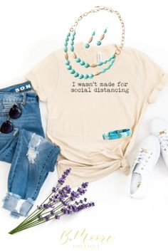 Social distancing graphic tee paired with Plunder jewelry.  #socialdistancing #graphictee #plunder #bmooreboutique #necklacetrend #earrings #spring2020fashion