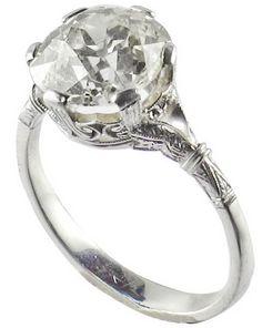Art Deco Cushion-Cut Diamond Engagement Ring.  An Art Deco white gold ring with an old cushion-cut diamond weighting 4.79 carats, color M-N, clarity VVS2. Italy, circa 1920.