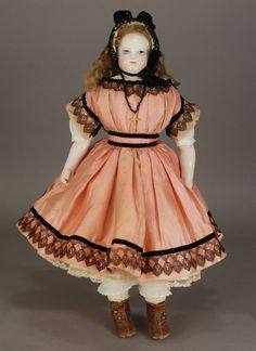 Carmel Doll Shop -Fashion Dolls- A dreamy vision in dramatic pink and black, this china Huret Poupee, circa 1850s