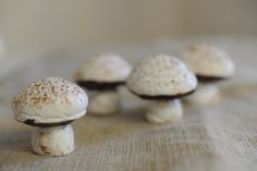 Meringue mushrooms - a fun and interesting garnish or dessert add-on.  I've made these and they really aren't hard, and there's a lot of room for error - real mushrooms aren't perfect either!  :)