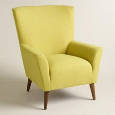 Our oversized armchair makes a retro statement with bright chartreuse green upholstery, a high wingback silhouette and mid-century-style splayed legs.