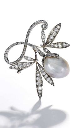 An antique natural pearl and diamond brooch, late 19th century. Set with a natural grey baroque-shaped pearl measuring approximately 20.0 x 16.1 x 12.8mm, to a scrolled foliate surmount set with circular-cut and rose diamonds.