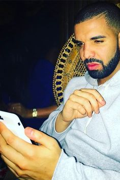 Drake wearing  Apple iPhone 7 Smart Battery Case