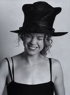 """Someone should have told me there was a cat in this hat before I put it on. He's making a mess of my hair.""  (Renée Kathleen Zellweger.)"