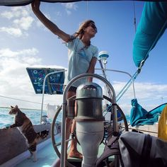 Congrats to Captain Liz Clark on her nomination for NatGeo Adventurer of of the year. Liz is an exploratory surfer who sails around the world in search of good waves. Here she is with her feline sidekick Amelia sailing in French Polynesia. @captainlizclark