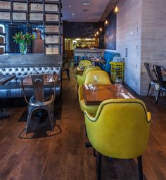 Melange restaurant is a project designed by In Arch in covers an area of 140 sqm and is located in London, UK Visual Merchandising, Mustard Chair, Uk Retail, Restaurant Interior Design, Restaurant Interiors, Branding, Accent Colors, Color Accents, Design Furniture
