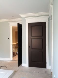 Dark doors, white trim and crown molding over each door. This will be the look in my home. :) Dark doors, white trim and crown molding over each door. This will be the look in my home. Dark Doors, Brown Doors, White Trim Wood Doors, Black Door, Wood Trim, Black Interior Doors, Interior Trim, Interior Door Colors, Interior Door Styles
