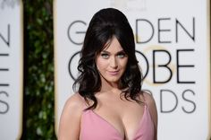 Always one to make a fashion statement, Katy Perry brought her A-game once again at the Golden Globes on Sunday. The pop star wowed on the red carpet in a pink, plunging Prada gown at the Beverly Hilton Hotel.