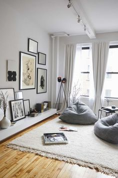 A comfortable neutral living room with greys and whites. I love the gallery wall and tall ceilings.