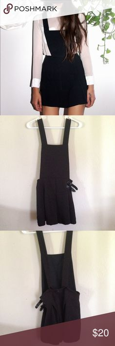 Black Overall Romper Black romper similar to the one in the first picture. Does not have pockets, but it has adjustable straps and a zipper on the back. Lightweight material, perfect for summer. Super cute! Worn twice. Only selling because I need extra cash, and also more closet space. Tops