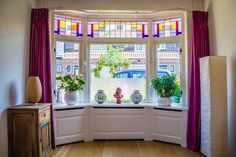 custom hand made windowsill in a authentic bay window with stained glass