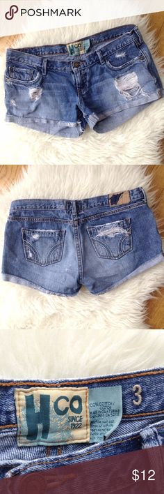 "Hco Distressed Denim Short Shorts Sz 3 Juniors Trendy style is yours wearing these denim short shorts from Hco!  Factory distressed with shredded holes, bleached areas and whiskers.  5-pocket styling. Ultra low rise. Size 3 Junior's.  Fabric is 100% cotton and is not stretchy. Pre-owned; good overall condition...back tag is partially worn off as seen in 2nd photo.  Approx. Measurements (lying flat):  Waist - 15"" Inseam - 2.5"" Length - 8.5"" front, 10.5"" back  Material:  100% Cotton  Thank you…"