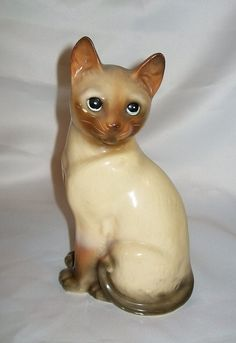 Vintage Siamese Cat Figurine by CrazyforthePast on Etsy https://www.etsy.com/listing/216392016/vintage-siamese-cat-figurine