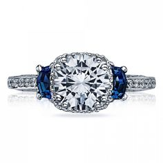 This show-stopper is elegance at it's finest. The sapphires on either side of the diamond build a deep contrast, while the center diamond is intensified with smaller diamonds shaping it. Tacori style no. Tacori Engagement Rings, Colored Engagement Rings, Buying An Engagement Ring, Engagement Sets, Engagement Ring Settings, Tacori Rings, Wedding Engagement, Tacori Jewelry, Jewelry Rings