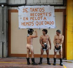"Firefighters from a fire station in Mieres, near Oviedo (Spain), are not posing for a calendar. They are protesting against governmental budget cuts inside their fire station, July 19, 2012. The banner says ""So many cuts have left us with nothing"". REUTERS/Eloy Alonso"