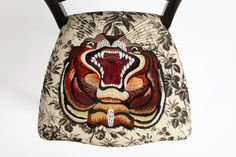 Printed Gucci chair with a tiger applique