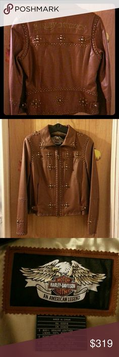 Harley-Davidson Women's Leather Jacket NWOT Never worn, kept in smoke-free home. Has tags on it, brown leather with brad-like embellishments and gold stitch lettering. Genuine leather jacket looking for a good home! Harley-Davidson Jackets & Coats