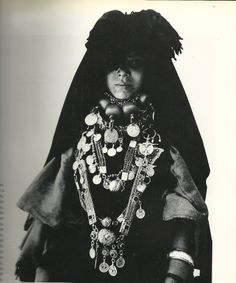 Young woman of Issafen,recognizable by the Pompom veil on her head.