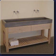 Concr3te betonnen wasbakken en houten meubels