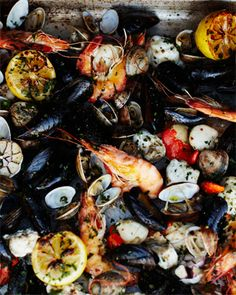 wood-fired shellfish...tossed out on butcher paper...an outdoor feast