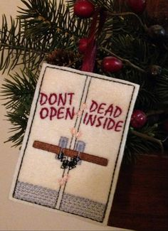 """Everyone loves zombies right? So why not add one to your holiday tree this year? Heck why not hang it anywhere you like all year long! This """"trapped"""" embroidered zombie ornament features a locked door"""
