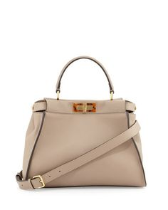 """Fendi Peekaboo satchel bag in silk calfskin. Golden hardware. Leather top handle with rings; 4"""" drop. Hinged tortoise plexi frame-top. Button-tabs at sides. Front and back turn-lock compartments. Inte"""