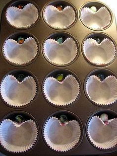 "How To Make Heart-Shaped Cupcakes With A Regular Tin - What A Cool Technique!Make fun heart-shaped muffins or cupcakes by simply lining a tin with paper liners, then drop a marble in between the tin and liner. (Balls of aluminum foil will also work.) Isn't this brilliant or what? Please ""like"" if you found this tip helpful and make sure to follow for more awesome tip."