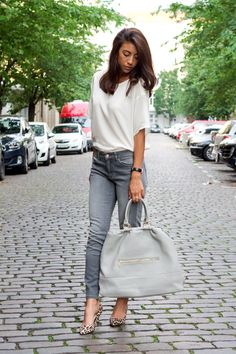 Oversized white top with grey skinniest and leopard pumps