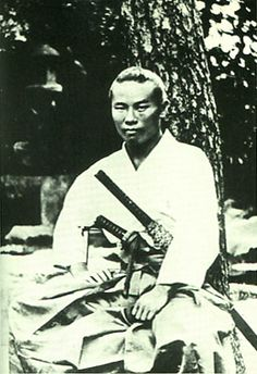Itō Hirobumi. Later the first Prime Minister of Japan.   He studied in the U.K. in his youth. He was assassinated in 1909 by the Korean anti-Japanese nationalist An Jung-geun.   This photograph was taken while he was still a young samurai of the Chōshū domain, in 1868.