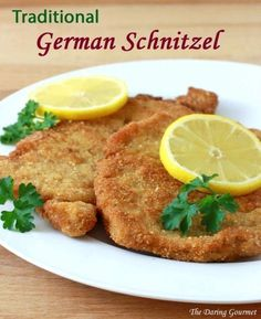 Authentic German Schnitzel (Schweineschnitzel) German schnitzel pork recipe traditional authentic – Must be served with a wedge of lemon. Traditionally this is made with veal. Pork Chop Recipes, Meat Recipes, Chicken Recipes, Dinner Recipes, Cooking Recipes, Pork Shnitzel Recipe, Chicken Chop Recipe, Pork Cutlet Recipes, Recipies