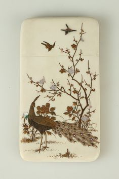 JAPANESE SHIBAYAMA GOLD LACQUER IVORY CARD CASE, Meiji Period. Inlaid with mother-of-pearl prunus branches, gold lacquer bamboo and bird decoration - 4 3/8 in. high.  Notes: PROVENANCE: Estate of Mary Lou B. Wein M.D., Bethesda, MD