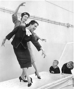 Marjorie and Maria Tallchief perform a impromptu workout in 1956. Their audience is Marjorie's twins, Alexander and George.
