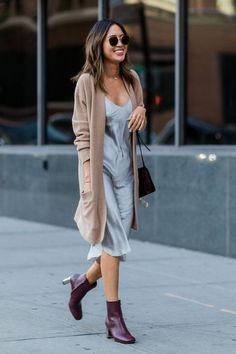 A slip dress suddenly feels fall-ready when you add a cozy cardigan and ankle boots. For a less casual approach, trade in the sweater for a furry jacket or stole.