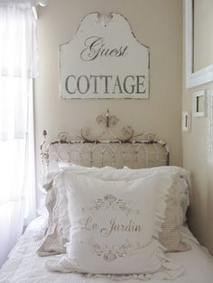 Guest Cottage sign in guest room at Junk Chic Cottage,  wrought iron gate for a headboard