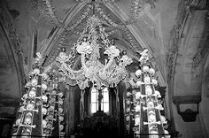 This is the most bizarre Chandalier in the world... It hangs in the Seldac Ossuary in Prague, Czech Republic...the bones are a memorial to victums of the Black Plague...this Chandalier also inspiried Rob Zombie to make one for the Lair Of Dr. Satan in his movie House Of 1000 Corpses. ~ Scott