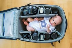 Totally going to happen someday.  :)  Photographers Are Squishing Their Babies Into Camera Bags, And It's Pretty Adorable