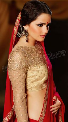 Gorgeous red sari or saree with pretty gold blouse. Check out the statement earrings