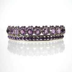 Amethyst // Victorian Amethyst diadem circa 1880, converted so that it can also be worn as a brooch. Consisting of two rows of faceted amethyst stones set in a silver setting.  Needs tiara frame.