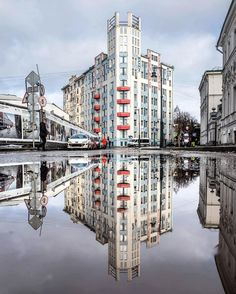 """Moscow in the evening. The big building in avantgard style with the words on it , is the house named """"Mosselprom"""".The house had being built very long from 1913 till 1925 under the project of the architect and the engineer N.Strukov. The pano on the other side was painted by the painters Rodchenko&Stepanova. The words on the pano """"Nowhere but only in Mosselprom"""" belong to the famous Soviet poet Vladimir Mayakovsky."""