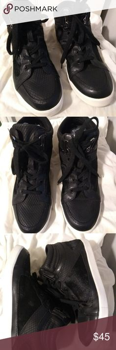 Calvin Klein Lyda Blk High Top calf hair sneakers Black high top fashion sneakers. Textured diamond pattern and some cow hair on sides and back make this sneaker truely special. Pre-owned but in good condition. Shows some wear. Calvin Klein Shoes Sneakers