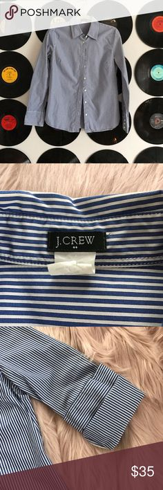 Classic JCrew dress shirt women's M Perfect for work with a pencil skirt or over a vintage tee with leather leggings + Converse on the weekend, this JCrew button down is a classic. White/blue stripes. Excellent user condition. A staple every wardrobe needs. Check out the rest of my closet to bundle and save 🤘🏻 J. Crew Tops Button Down Shirts