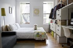 Small space solutions: muted palette, lack of clutter, lots of white storage. Sw0_rect540 via Apartment Therapy