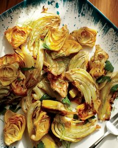 Roasted Fennel and Artichoke Hearts - Martha Stewart Recipes..serve in a tossed salad, or mix with mayo, fresh english peas, and minced onion for a vegetarian-substitute for chicken salad as sandwich filling.