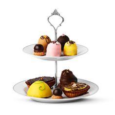 Due piani di dolcezza Portadolci con supporto in metallo e piatto in ceramica. E' alto 22 cm e il piatto alla base, il più grande ha un diametro di 23 cm. 4 Euro!