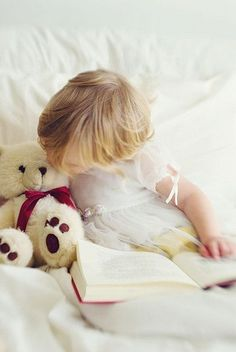 little girl and her teddy bear...