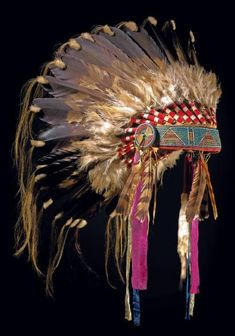 coiffe indienne...antique indian headdress.  Wherever this headdress is,  I know its not with the original owner/family,  or tribe.   Sad