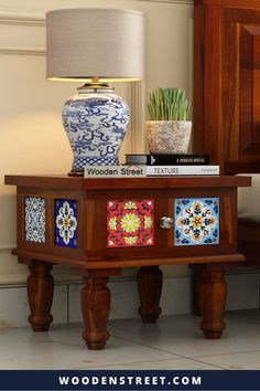 For all those bohemians out there, here is a bedside table to accompany your wild side. With vibrant and elegant tiles, and curvaceous tapered legs, the table renders everything else bland. Best used with the Boho bed and other furniture pieces from the Boho family. The painted tiles instill in you a feeling of freedom and Made from high quality Sheesham wood and available in four different finishes. Antique Bedside Tables, Walnut Bedside Table, Wood Nightstand, Wooden Street, Small Furniture, Bedroom Furniture, Antique House, Boho Bedding, Vibrant